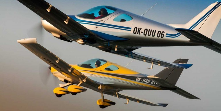Two light aircraft fly in close formation